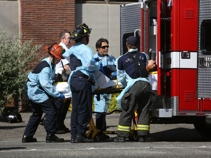 Seattle firefighters remove a